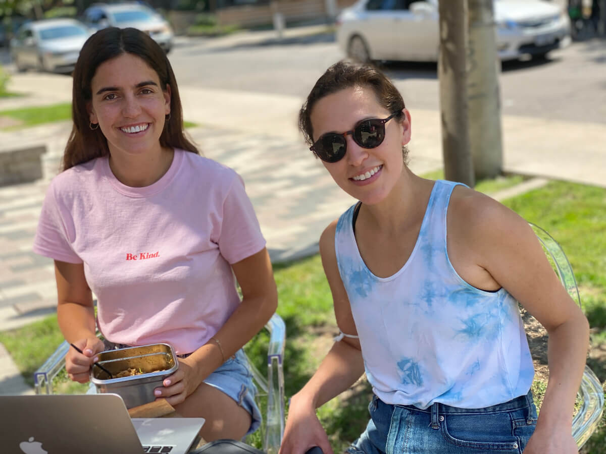 Suppli co-founders Julianna Greco and Megan Takeda-Tully holding one of their reusable containers