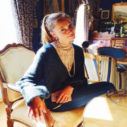 Writer Mackenzie Patterson seated in a sunny room